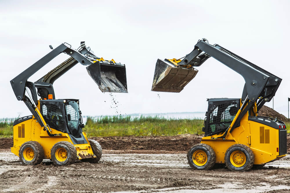 difference between a compact track loader and a skid steer loader