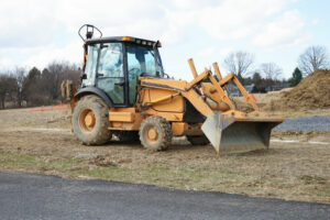 how to level ground with a front end loader